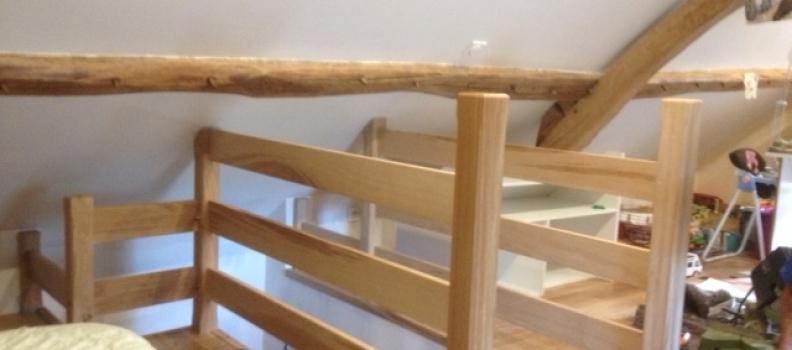 Fabrication en chêne brun d'un garde corps d'étage à Nucourt Val d'oise proche magny en vexin 95